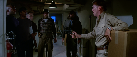 Garry_assures_the_men_of_his_innocence_-_The_Thing_(1982)